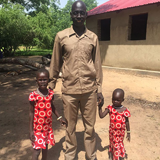 Pastor Peter and his daughters