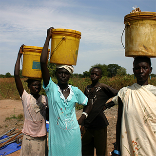 Women carrying water to home